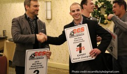 Bart Brejcha passing off the #1 plate to Drew Jankord