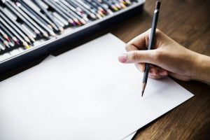 Someone sketching with a pencil